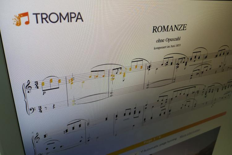 Photo of a screen showing Clara Schumann's Romanze in a-minor (digital score) with rehearsal highlights